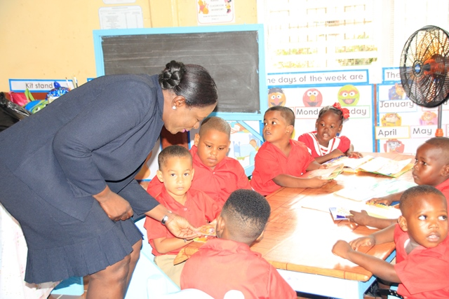 Minister Henry sharing a moment with students of Savannah Park Nursery School.