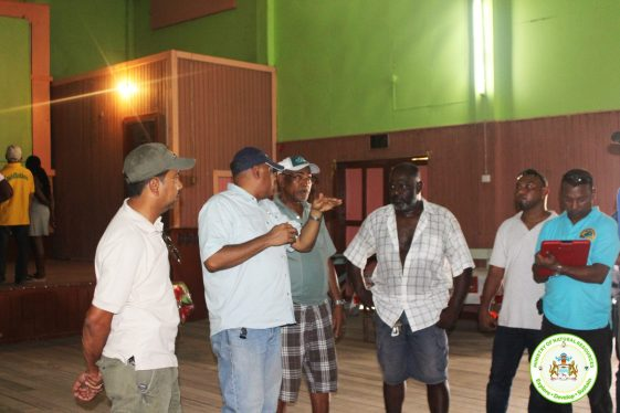 Minister Trotman conducting internal inspection along with club manager Leroy Saul (opened shirt) among others.