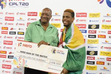 Shimron Hetmyer receiving his Man-of-the-Match cheque from Minister of State Joseph Harmon.