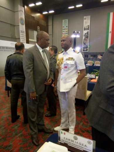 Minister of State, Mr. Joseph Harmon in discussion with Rear Admiral Hayden Pritchard, Chief of Defense Staff of Trinidad and Tobago.