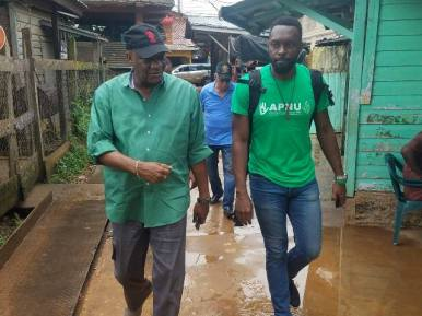 Minister Joseph Harmon and Director of Sport, Christopher Jones during the walkabout.