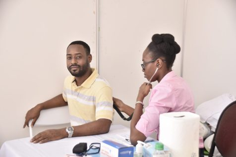 Staff of the Ministry of the Presidency take advantage of the available medical screening at this morning's health fair