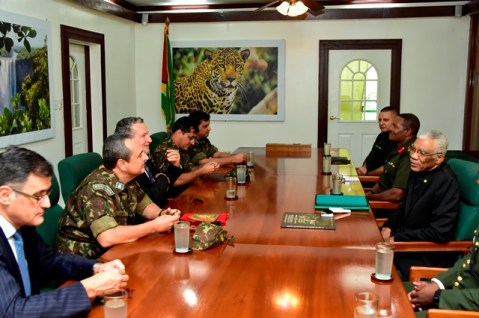 President David Granger shares a light moment with Colonel Nilton de Figueiredo Lampert, Commanding Officer of the Brazilian's Jungle Warfare Training Centre as Brazil's Ambassador to Guyana, Mr. Lineu Pupo de Paula, Chief of Staff (acting), Colonel Trevor Bowman of the Guyana Defence Force (GDF) and Officers of the GDF and the Brazilian Army look on.
