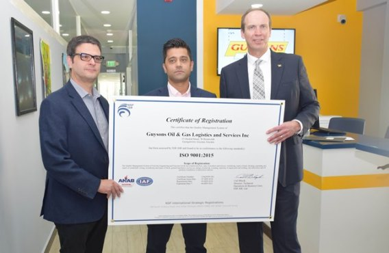 [From left] Project Director of CLBD, Patrick Henry, Chief Executive Officer of Guysons Oil and Gas, Faizal Khan and Operations Manager of ExxonMobil Guyana, Mike Ryan with the ISO 9001:2015 certificate.