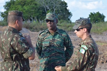 Director General (ag) of the Civil Defence Commission (CDC), Lieutenant Colonel, Kester Craig in discussion with members from the Brazilian Army.
