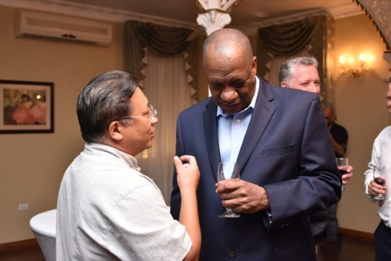 Minister of State, Mr. Joseph Harmon, who is performing the functions of Foreign Affairs Minister, listens attentively as Chinese Ambassador to Guyana, Mr. Cui Jianchun makes a point during the reception this evening