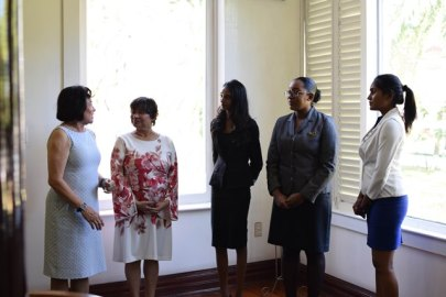 Prime Minister for a day - Delecia George, President for a day - Renuka Persaud, and Canadian High Commissioner for a day - Sara Mohan meet with First Lady, Mrs. Sandra Granger.