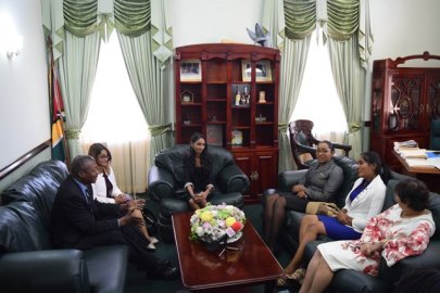 Prime Minister for a day - Delecia George, President for a day - Renuka Persaud, and Canadian High Commissioner for a day - Sara Mohan meet with Speaker of the National Assembly, Dr. Barton Scotland.
