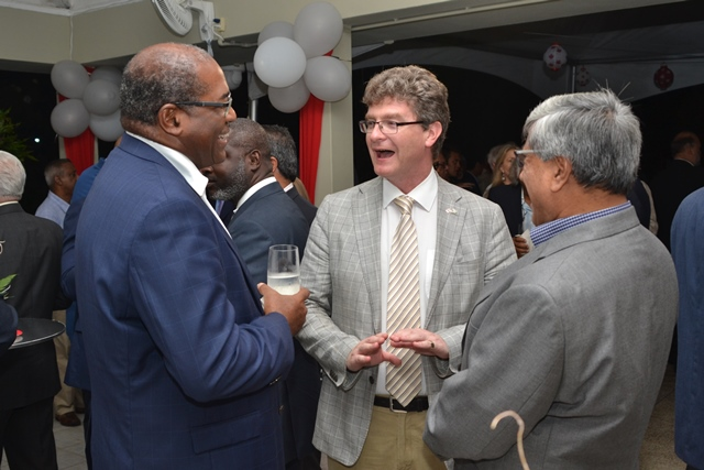 British High Commissioner, Gregory Quinn, share a laugh with one of the Directors of Guyana Oil and Gas Association (GOGA) and another at a networking reception hosted by the Canadian High Commissioner.