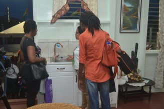 This H2Ogy representative demonstrating water pressure in the model home at the Ministry of Communities green community display