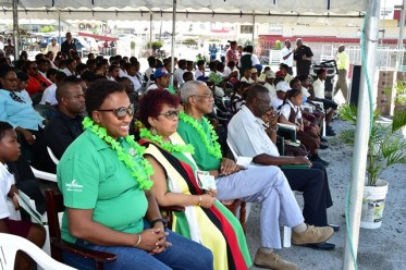 (Seated front row from left to right) Minister within the Ministry of Public Infrastructure, Ms. Annette Ferguson, Minister of Social Protection, Ms. Amna Ally, President David Granger and Regional Executive Officer, Region Two, Mr. Rupert Hopkinson pay keen attention to a cultural presentation during a community meeting held at the Anna Regina car park.