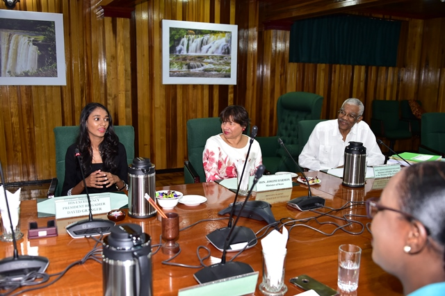President of the Day, Ms. Renuka Persaud (left) addressing Cabinet as President David Granger and Canadian High Commissioner to Guyana, Ms. Lilian Chatterjee look on.