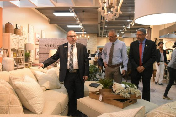 : Minister of Business, Dominic Gaskin, (centre) and Managing Director of Unicomer Group, Clyde de Haas gets guided tour of store from Ashley representative Jesus Dacal