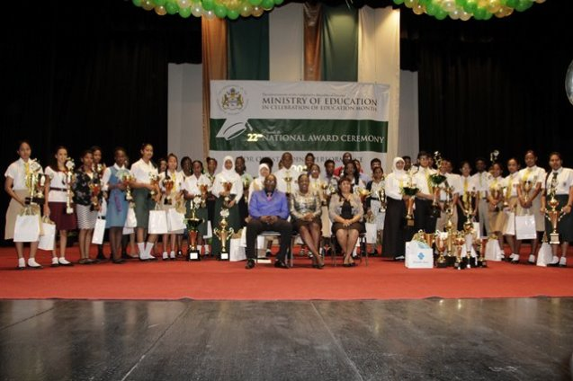 The National Awardees pose for a photograph with Minister of Education, Dr. Hon. Nicolette Henry (seated centre), Permanent Secretary of the Ministry of Education, Ms. Adele Clarke and Chief Education Officer, Mr. Marcel Hutson.