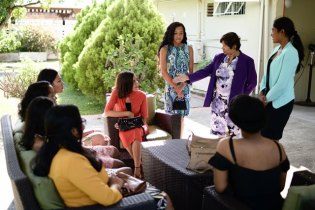 High Commissioner Chatterjee is joined by High Commissioner of the Day, Sara Mohan [right] as she greets the girls.