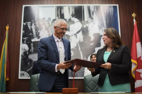 Minister of Business, Mr. Dominic Gaskin and Newfoundland Minister of Natural Resources, Ms. Siobhan Coady exchange a few words after signing the MoU on enhanced collaboration in the area of oil and gas development today.