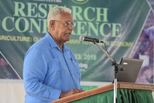 Minister of Agriculture, Noel Holder addressing the audience at the National Agriculture Research and Extension Institute (NAREI) Research Conference at the Guyana School of Agriculture, Mon Repos, East Coast Demerara