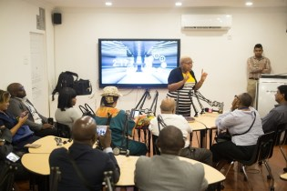 Information Technology Coordinator Marcia Thomas (center standing) addressing the delegates of the Commonwealth Association for Public Administration and Management (CAPAM) on how the Smart Classroom works.