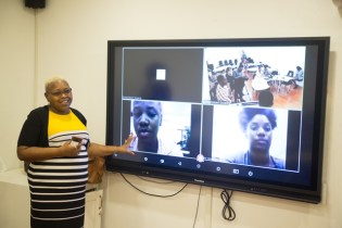 Information Technology Coordinator Marcia Thomas giving a demonstration of how the Smart Classroom works.