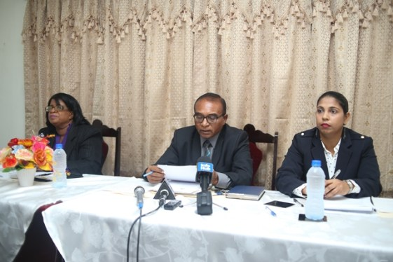 Chairman of the Integrity Commission, Attorney Kumar Doraisami [centre] with Commissioner Rosemary Benjamin-Noble [left] and Secretary Amanda Jaisingh.