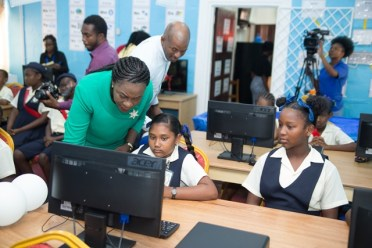 Minister of Education, Nicolette Henry engaging with students.