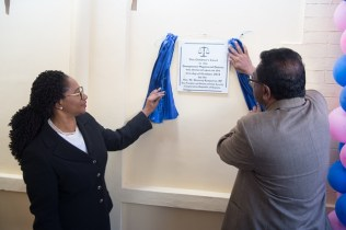 Minister of Public Security Khemraj Ramjattan and Acting Chancellor, Madam Justice Yonette Cummings-Edwards unveiling the Children's Court Plaque.