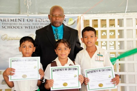 ACEO Primary, Owen Pollard and students of the Saraswat Primary School who were honoured for their regular and punctual school attendance.