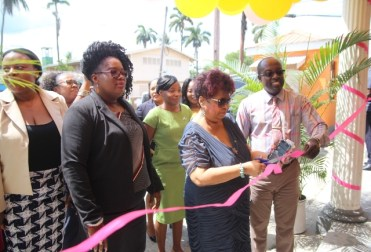 Minister of Social Protection, Amna Ally cuts the ribbon to commission the Ministry's Region 10 Office.