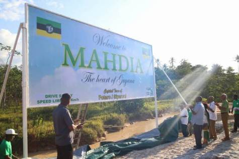 President Granger, Minster of State Joseph Harmon and Minister of Communities, Ronald Bulkan admire the sign board welcoming visitors to the town of Mahdia, after its unveiling.