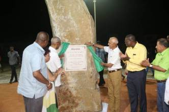 President David Granger and Minister of Communities, Ronald Bulkan unveil the plaque on the Mahdia Monument to officially declare the community a town. Looking on and applauding are (left) Minister of Social Protection, Amna Ally, Minister of State, Joseph Harmon; (right) Minister of Public Infrastructure David Patterson and Minister of Indigenous People's Affairs Sydney Allicock.