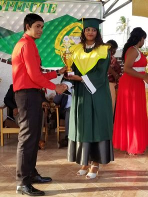 Valedictorian, Bibi Ali receiving one of her awards.