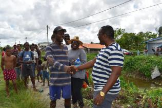 Deputy Commissioner of Police, Paul Williams greeting a resident of Sophia
