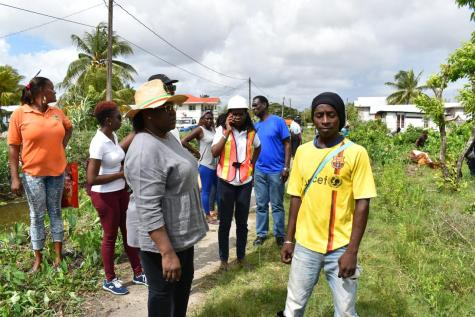 Minister Simona Broomes and some of the Sophia residents assemble before beginning the clean up