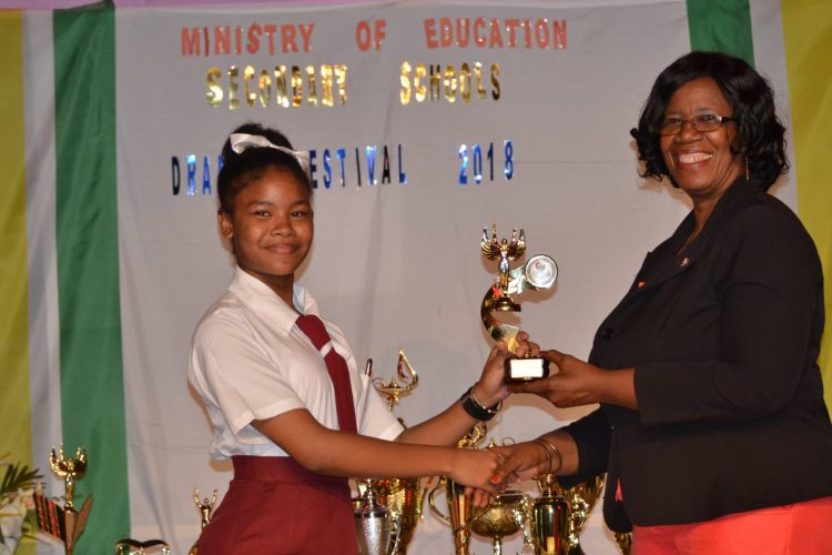 Best Supporting Actress, Akeisha George of North-West Secondary receiving her award from Administrator (ag) of the Unit of Allied Arts, Lorraine Barker-King
