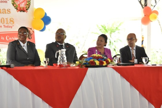 Minister of Public Affairs, Ms. Dawn Hastings-Williams (seated, second from right) Chairman of the Salvation Army Advisory Board, Mr. Edward Boyer (first from right) and other members of the Salvation Army pay keen attention to the lively programme held to launch the 'Christmas kettle' appeal.