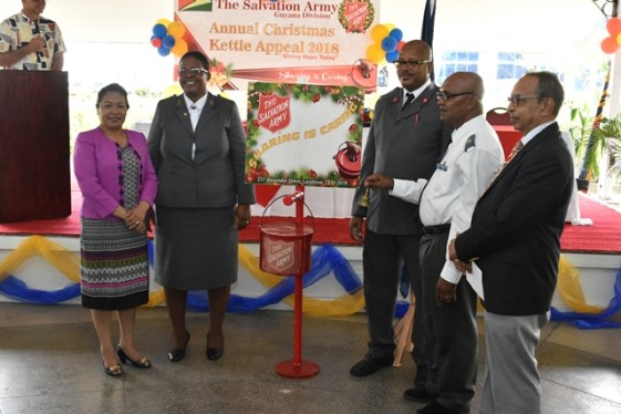 Minister of Public Affairs, Ms. Dawn Hastings-Williams (first, left) and other members of the Salvation Army at the launch of the 'Christmas kettle' appeal at the Georgetown Club.