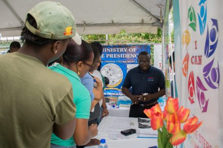 Residents of Agricola engage the booths that participated in the job fair