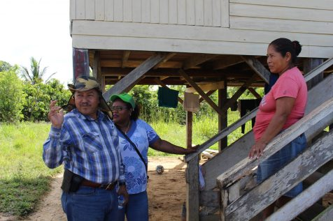 Minister of Indigenous Peoples' Affairs, Sydney Allicock engaging a resident of Oronoque