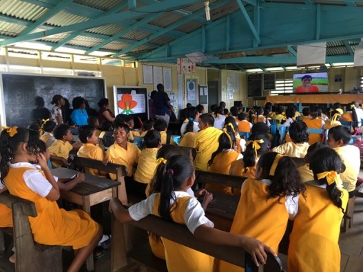 The children of Baramita Primary, as they view the screening of the healthy eating and nutrition video.