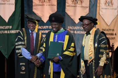Musician Eddy Grant receives his Doctor of Letters from Chancellor of UG, Professor Eon Harris, in the presence of Vice Chancellor of UG, Professor Ivelaw Griffith.