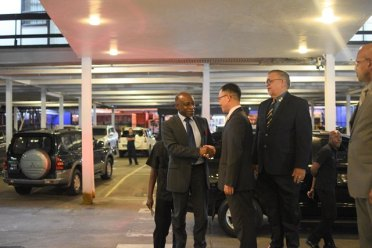 Minister of Foreign Affairs and acting Prime Minister, Carl Greenidge, greeting South Korea's Chargé d'affaires from the South Korean Embassy, Venezuela Dong-il Oh and Honorary Consul Ramesh Dookhoo.