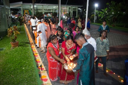 Invitees lighting diyas at the Statehouse Diwali celebrations.