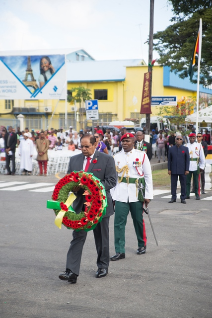 Prime Minister Moses Nagamootoo who is performing the duties of President prepares to lay the first wreath at the Cenotaph monument in honour of those who served and those fallen during World Wars I and II.