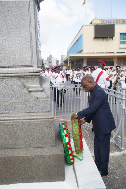 Minister of Foreign Affairs Carl Greenidge who is performing the functions of Prime Minister lays a wreath.