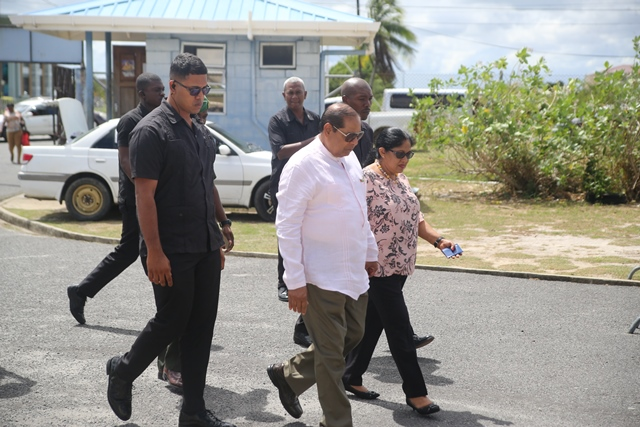 Prime Minister Moses Nagamootoo and his wife, Mrs. Sita Nagamootoo arriving at the National Aquatic Centre to cast their ballots for LGE.