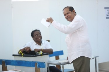 Prime Minister Moses Nagamootoo just before he cast his ballot .