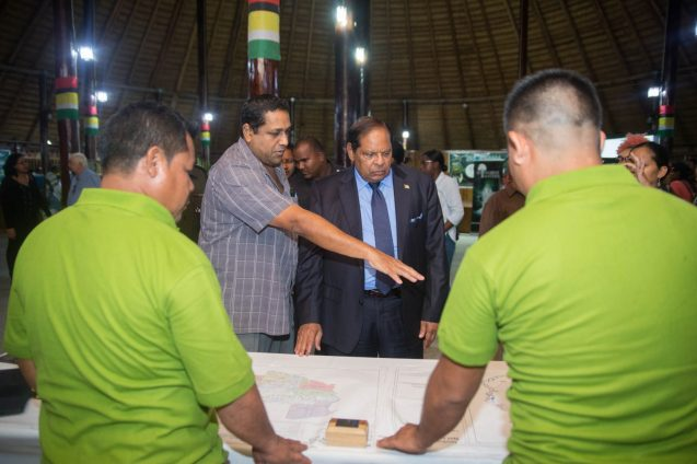 Prime Minister Moses Nagamootoo being shown the areas of sustainable forestry in the Iwokrama Rainforest