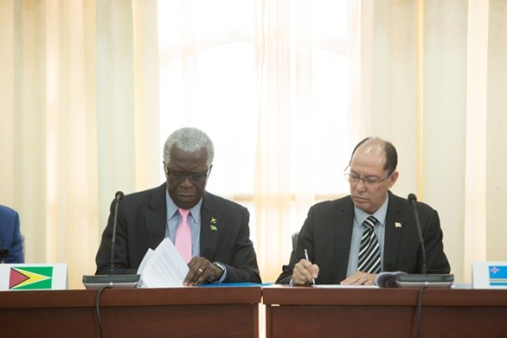 Director-General, Guyana Civil Aviation Authority (GCAA), Retired Lieutenant Colonel, Egbert Field and Acting Director-General, Department of Civil Aviation, Aruba, Anthony Kirchner signing the MOU.
