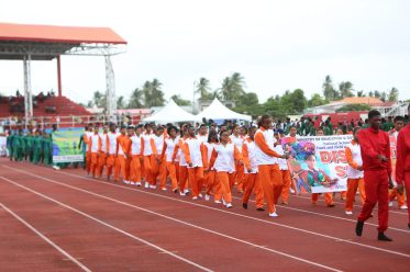 Students from the various districts during the march past at the opening of the 58th National Schools' Cycling, Swimming and Track and Field Championships