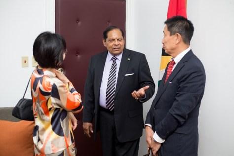Prime Minister Moses Nagamootoo in conversation with Japanese Ambassador, Mitsuhiko Okada and his wife, Mrs. Mari Okada.